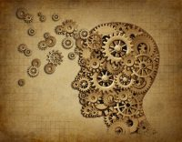 Human intelligence brain function with grunge texture made of machine cogs and gears representing education and teaching of strategy and psychological mental ne